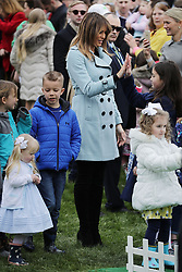 WASHINGTON, DC - APRIL 02: (AFP OUT) U.S. first lady Melania Trump high fives a young participant in the lawn bowling activity during the 140th annual Easter Egg Roll on the South Lawn of the White House April 2, 2018 in Washington, DC. The White House said they are expecting 30,000 children and adults to participate in the annual tradition of rolling colored eggs down the White House lawn that was started by President Rutherford B. Hayes in 1878. (Photo by Chip Somodevilla/Getty Images)