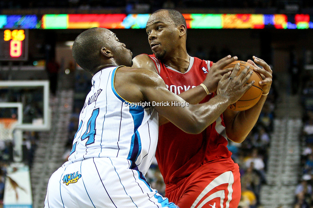 April 6, 2011; New Orleans, LA, USA; Houston Rockets center Chuck Hayes (44) is guarded by New Orleans Hornets power forward Carl Landry (24) during the third quarter at the New Orleans Arena. The Hornets defeated the Rockets 101-93 and clinched a playoff spot with the victory.   Mandatory Credit: Derick E. Hingle-US PRESSWIRE
