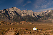 Aliner camping in the Alabama Hills near Lone Pine, California, USA, with Mt. Whitney in the background lit by moonlight.