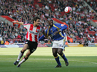 Photo: Lee Earle.<br /> Southampton v Cardiff City. Coca Cola Championship. 21/10/2007. Cardiff's Jimmy Floyd Hasselbaink (R) battles with Alan Bennett.