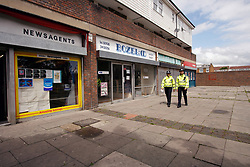 Community Police Support Officers patrolling estate shopping area, Harold Hill, Havering London UK