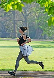 ©Licensed to London News Pictures 08/04/2020  <br /> Greenwich, UK. A female runner at full sprint. People get out of the house from Coronavirus lockdown to exercise and enjoy the sunny weather in Greenwich park,Greenwich, London. Photo credit:Grant Falvey/LNP