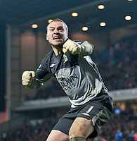 BLACKBURN, ENGLAND - Wednesday, December 2, 2009: Blackburn Rovers' goalkeeper Paul Robinson celebrates after making his first save in the penalty shoot-out to knock out Chelsea during the Football League Cup Quarter-Final match at Ewood Park. (Photo by David Rawcliffe/Propaganda)