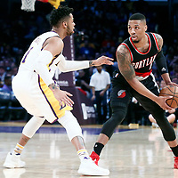 26 March 2016: Los Angeles Lakers guard D'Angelo Russell (1) defends against Portland Trail Blazers guard Damian Lillard (0) during the Portland Trail Blazers 97-81 victory over the Los Angeles Lakers, at the Staples Center, Los Angeles, California, USA.