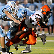 New Hanover's Jeavone Batts rushes against South Florence during the Carolinas Clash Kickoff Saturday August 30, 2014 in Myrtle Beach, S.C. (Jason A. Frizzelle)