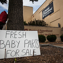 | Weston Kenney | westonkenney@archstl.org | Instagram: westonkenney <br /> <br /> Protesters stood outside Planned Parenthood facility on Forest Park Blvd. in St. Louis in response to a video that surfaced that showed a Planned Parenthood worker negotiating selling fetal tissue from abortions on Tuesday, July 21, 2015.