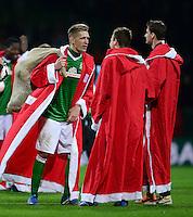 FUSSBALL   1. BUNDESLIGA   SAISON 2013/2014   17. SPIELTAG SV Werder Bremen - Bayer 04 Leverkusen             21.12.2013 Nils Petersen, Philipp Bargfrede und Sebastian Mielitz (v.l., alle SV Werder Bremen) haben sich jeweils ein Weihnachtsmann-Kostuem angezogen