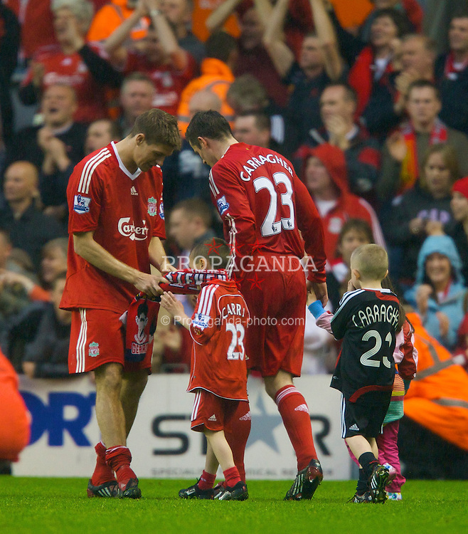 LIVERPOOL, ENGLAND - Sunday, May 4, 2008: Liverpool's captain Steven Gerrard MBE with team-mate Jamie Carragher and his sons during the players' lap-of-honour following the final Premiership match of the season at Anfield. (Photo by David Rawcliffe/Propaganda)