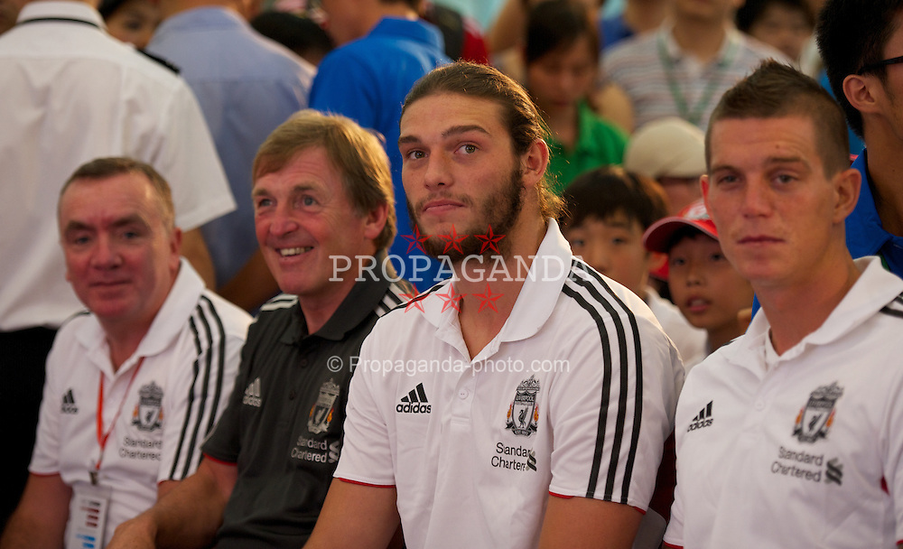 GUANGZHOU, CHINA - Tuesday, July 12, 2011: Liverpool's manager Kenny Dalglish, Andy Carroll and Daniel Agger during a promotional event for Standard Charter at the Tianhe Shopping Center during day two of the club's Asia Tour. (Photo by David Rawcliffe/Propaganda)