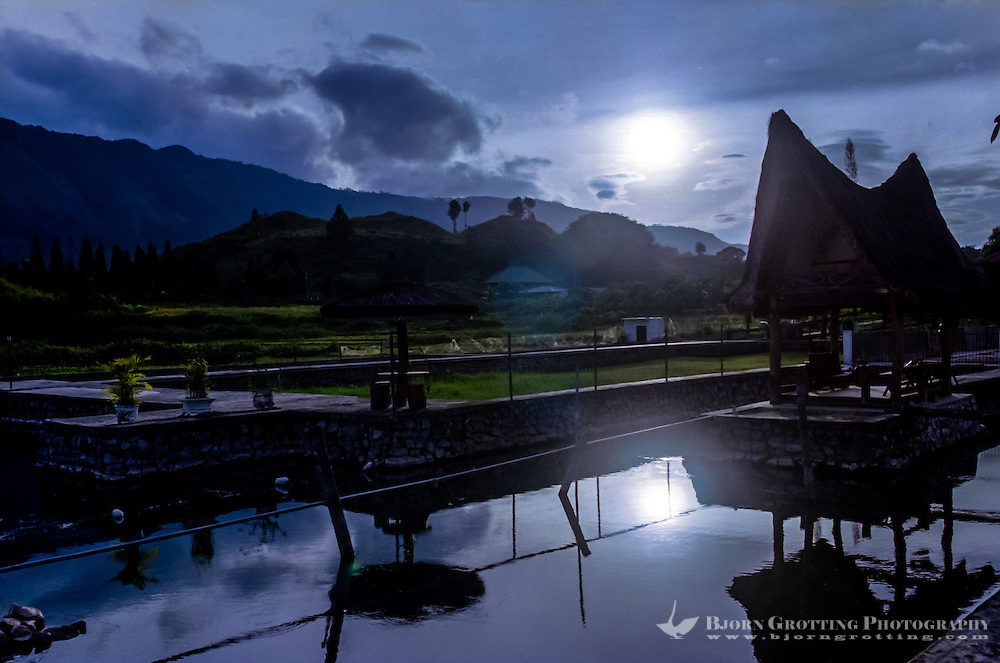 Indonesia, Sumatra. Samosir. Buildings at the water. Tuk Tuk.