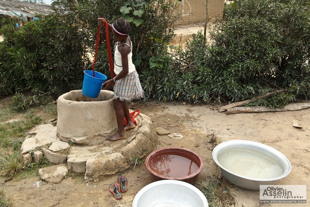 A girl draws water from a well in the village of Popoko, Bas-Sassandra region, Cote d'Ivoire, on Sunday March 4, 2012.
