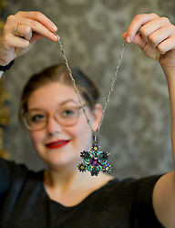Pictured: Jaine Heggie from Bonham's auctioneers with one of the highlights of the sale, an arts and crafts necklace from the 1920's.<br /> <br /> &copy; Dave Johnston / EEm