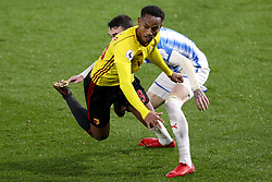 16 December 2017 - Premier League Football - Watford v Huddersfield Town - Andrew Carrillo of Watford goes down after jostling with Scott Malone of Huddersfield - Photo: Charlotte Wilson / Offside