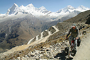 He bikes in jeans! Harald Mueller climbs the western slope of 15,640 ft. Paso de Portachuelo in Peru's Cordillera Blanca. - Huascaran National Park - South America