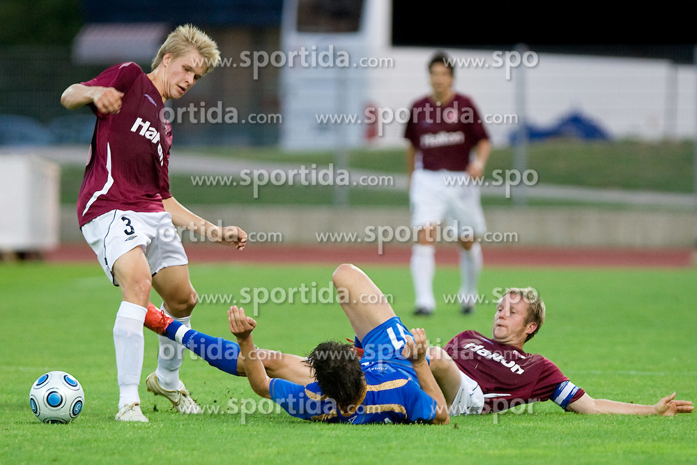 Henri Toivomaki and Etien Velikonja of Gorica and Jukka Vanninen at 1st football match of 2nd preliminary Round of UEFA Europe League between ND Gorica and FC Lahti, on July 16 2009, in Nova Gorica, Slovenia. (Photo by Vid Ponikvar / Sportida)