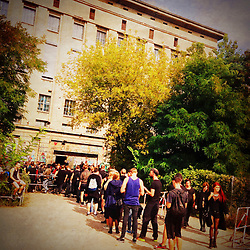 Clubbers queuing to enter infamous Berghain nightclub on a Sunday afternoon in Berlin Germany