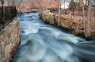 The Powow River running through historic dowtown Amesbury, Massachusetts.
