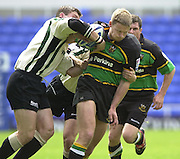 19/05/2002.Sport -Rugby Union- Zurich Championship Quarter final.London Irish v Northampton.Saints Nick  Beal is held by the exiles defence...[Mandatory Credit, Peter Spurier/ Intersport Images].