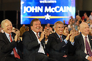 YORK, PA - AUGUST 12: From left, Senator Joseph Lieberman, former Secretary of Homeland Security Tom Ridge, Congressman Todd Plats, and Senator Arlen Specter applaud while Republican Presidential Candidate Sen. John McCain (R-Az.) speaks at a Town Hall Meeting while on the campaign trail in the Toyota Arena August 12, 2008 in York, Pennsylvania. Over one thousand people attended the Town Hall.  (Photo by William Thomas Cain/Getty Images)