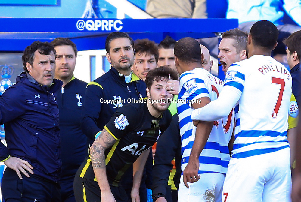 7 March 2015 - Barclays Premier League - QPR v Tottenham Hotspur - Karl Henry of QPR is restrained after clashing with Ryan Mason of Tottenham Hotspur - Photo: Marc Atkins / Offside.