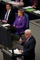 """19 MAY 2010, BERLIN/GERMANY:<br /> Frank-Walter Steinmeier, SPD Fraktionsvorsitzender, haelt eine Rede, im Hintergrund: Guido Westerwelle (hinten L), FDP, Bundesaussenminister, und Angela Merkel (hinten R), CDU, Bundeskanzlerin, Bundestagsdebatte zur Regierungserklaerung der Bundeskanzlerin """"Maßnahmen zur Stabilisierung des Euro"""", Plenum, Deutscher Bundestag<br /> IMAGE: 20100519-01-040<br /> KEYWORDS: speech"""