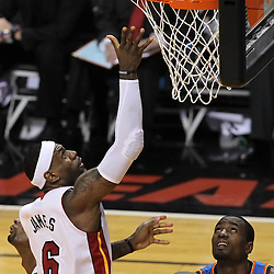 Jun 19, 2012; Miami, FL, USA; Miami Heat small forward LeBron James (6) drives to the basket against Oklahoma City Thunder power forward Serge Ibaka (9) during the first quarter in game four in the 2012 NBA Finals at the American Airlines Arena. Mandatory Credit: Derick E. Hingle-US PRESSWIRE