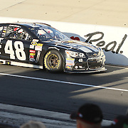 "Jimmie Johnson (48) drives towards winner circle after winning NASCAR SPRINT CUP ""AAA 400″ auto race at Dover International Speedway in Dover, DE Sunday,  Sept  29, 2013"