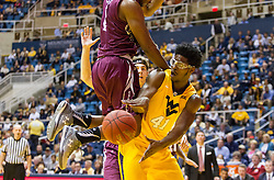 Dec 21, 2015; Morgantown, WV, USA; West Virginia Mountaineers forward Devin Williams (41) passes under the basket during the first half against the Eastern Kentucky Colonels at the WVU Coliseum. Mandatory Credit: Ben Queen-USA TODAY Sports