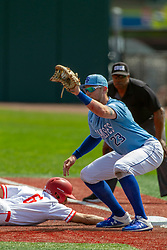 NORMAL, IL - May 01: Aidan Huggins dives to first past Dane Tofteland, Wayne Harris Umps during a college baseball game between the ISU Redbirds and the Indiana State Sycamores on May 01 2019 at Duffy Bass Field in Normal, IL. (Photo by Alan Look)