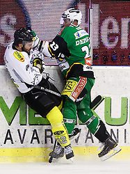 29.01.2013, Hala Tivoli, Ljubljana, SLO, EBEL, HDD Telemach Olimpija Ljubljana vs Dornbirner Eishockey Club, 4. Qualifikationsrunde, in picture Damjan Dervaric (HDD Telemach Olimpija, #23) hits Nicolas Petrik (Dornbirner Eishockey Club, #12) during the Erste Bank Icehockey League 2nd Qualification Round match between HDD Telemach Olimpija Ljubljana and Dornbirner Eishockey Club at the Hala Tivoli, Ljubljana, Slovenia on 2013/01/29. (Photo By Matic Klansek Velej / Sportida)