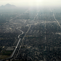 A small mountain rises above the smog in Phoenix, Arizona during the morning. Phoenix is one of the fastest growing metropolitan areas with a population of 3.3 million people.