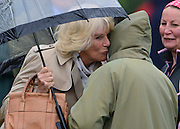 © Licensed to London News Pictures. 10/05/2013. Windsor, UK  Camilla, Duchess of Cornwall greets HRH Queen Elizabeth II with a kiss as she watches horses in the show. The Royal Windsor Horse Show, set in the grounds of Windsor Castle. Established in 1943, this year will see the Show celebrate its 70th anniversary. Photo credit : Stephen Simpson/LNP
