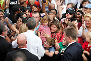 Jessica Hughes of Hilliard shields her three kids, including Julia, 3, Aidan, 8, and Evan, 6, from the rush of people rushing to shake hands with President Barack Obama after he spoke at a campaign rally in Schiller Park in the German Village neighborhood of Columbus on Sept. 17, 2012. (Dispatch photo by Adam Cairns)<br /> <br /> Adam Cairns came to the Dispatch from ThisWeek Newspapers in August 2012.<br /> Photo published Sept. 18, 2012.<br /> Ohioans, bombarded with advertisements and frequently visited by candidates, was a focal point of the presidential election. The mayhem that surrounded the election can be seen in this one moment at the end of the president's speech in German Village.<br /> <br /> TECHNICAL INFORMATION<br /> Canon EOS 5D Mark II<br /> Canon 70-200 f2.8 at 95mm<br /> ISO 320<br /> f4<br /> 1/640