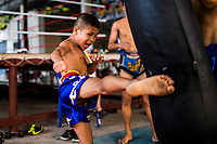 Young children practice Muay Thai before school at Tor Nongtapan in Rayong, Thailand.
