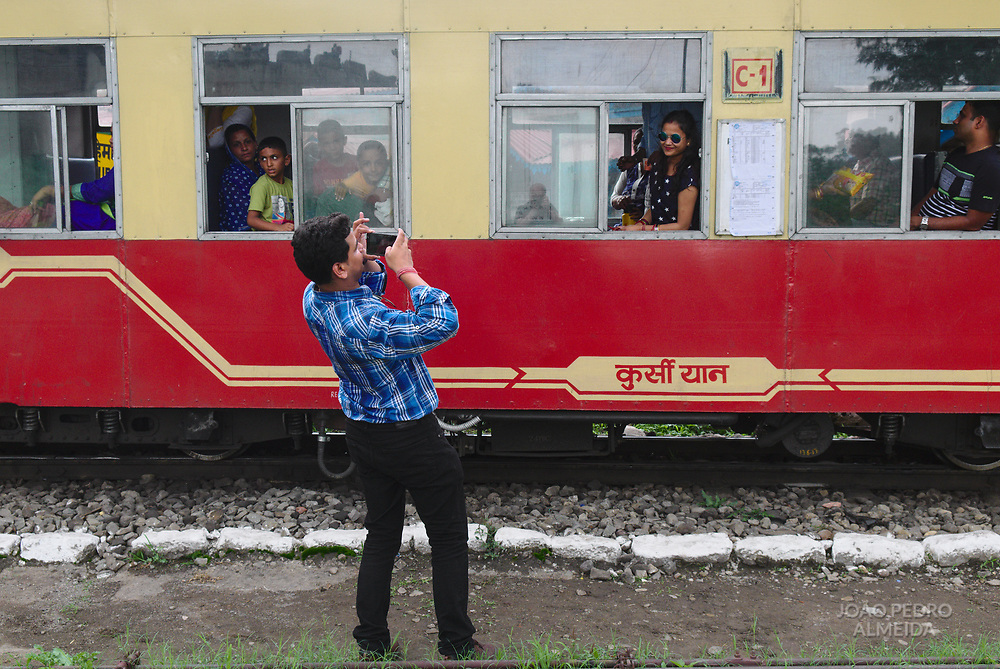 "The narrow ""toy train"" (small, narrow-gauge train) that slowly climbs the almost 100km from the plains of Kalka to Shimla, sitting on top of the Lower Himalayas."