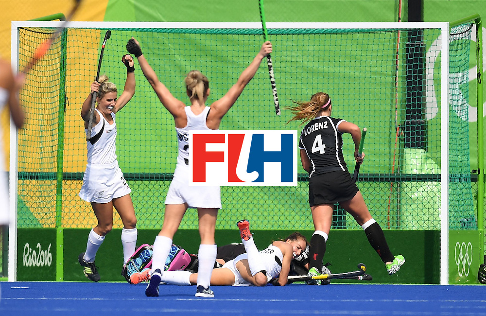 New Zealand's Petrea Webster (C) looks back after scoring a goal during the women's field hockey New Zeland vs Germany match of the Rio 2016 Olympics Games at the Olympic Hockey Centre in Rio de Janeiro on August, 8 2016. / AFP / MANAN VATSYAYANA        (Photo credit should read MANAN VATSYAYANA/AFP/Getty Images)