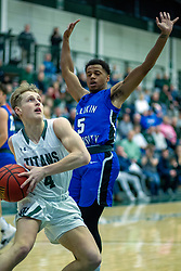 BLOOMINGTON, IL - January 04: Luke Yoder hustles past Troy Burrows during a college basketball game between the IWU Titans  and the Millikin Big Blue on January 04 2020 at Shirk Center in Bloomington, IL. (Photo by Alan Look)