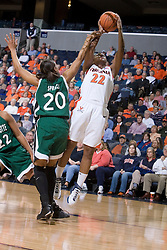 Virginia Cavaliers Guard Monica Wright (22) shoots over Charlotte 49ers Ashley Spriggs (20).  The Virginia Cavaliers women's basketball team defeated The University of North Carolina - Charlotte 49ers 74-72 in the 2nd round of the Women's NIT at John Paul Jones Arena in Charlottesville, VA on March 19, 2007.