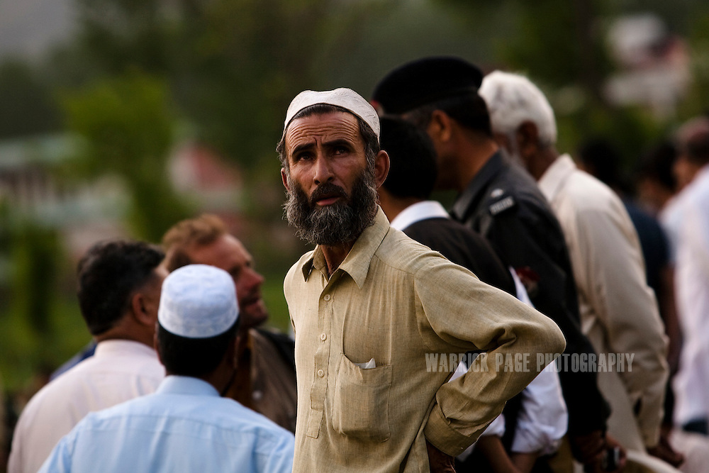 A Pakistani man looks up to the home of Osama Bin Laden outside the compound where he was killed in an operation by US Navy Seals, on May 4, 2011, in Abottabad, Pakistan.  The operation, code-named Operation Neptune Spear, was launched from neighbouring Afghanistan by Seal Team Six. U.S. forces took bin Laden's body to Afghanistan for identification, then dumped it the Arabian Sea. Pakistan has since been widely suspected as having prior knowledge of his whereabouts as the compound was less than a kilometre from the country's biggest military academy. Osama bin Laden was allegedly responsible for supporting the bombing of the US Embassy in Nairobi, Kenya, the attack on the USS Cole and the suicidal attacks of September 11, 2001 in the US. (Photo by Warrick Page)