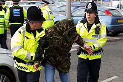 © licensed to London News Pictures. Heywood, UK  03/03/2012. Police detain a man after a National Front demonstration in Heywood, Greater Manchester. The National Front hold a demonstration in Heywood, Greater Manchester. They protested against an alleged paedophile ring that had been operating in the area. There is currently a case being tried at Liverpool Crown Court in relation to the allegations. Last Thursday (23rd February) a protest organised in the town in relation to the same story resulted in Asian business being attacked by an angry mob. Photo credit should read Joel Goodman/LNP