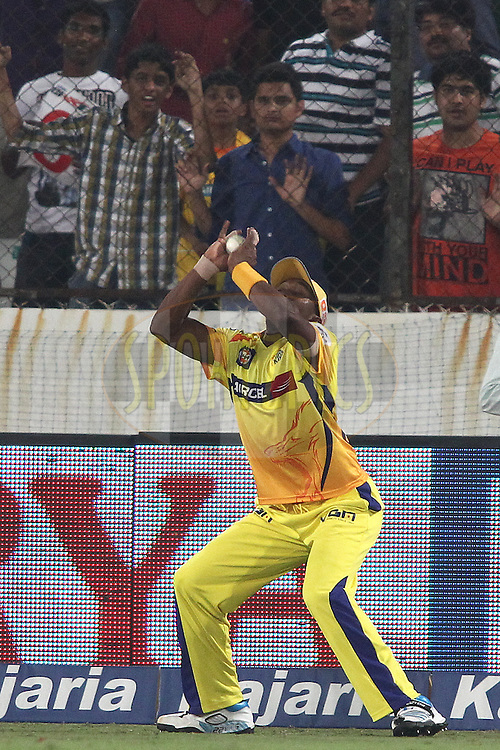Dwayne Bravo of the Chennai Super Kings takes the catch to get Thisara Perera of the Kings XI Punjab wicket during the second semi final match of the Oppo Champions League Twenty20 between the Kings XI Punjab and the Chennai Superkings held at the Rajiv Gandhi Cricket Stadium, Hyderabad, India on the 2nd October 2014<br /> <br /> Photo by:  Shaun Roy / Sportzpics/ CLT20<br /> <br /> <br /> Image use is subject to the terms and conditions as laid out by the BCCI/ CLT20.  The terms and conditions can be downloaded here:<br /> <br /> http://sportzpics.photoshelter.com/gallery/CLT20-Image-Terms-and-Conditions-2014/G0000IfNJn535VPU/C0000QhhKadWcjYs