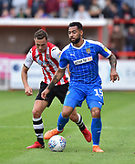 Kane Hemmings (15) of Notts County with Jordan Tillson (6) of Exeter City closing in during the EFL Sky Bet League 2 match between Exeter City and Notts County at St James' Park, Exeter, England on 8 September 2018.
