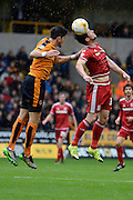 Middlesbrough striker David Nugent beats Wolverhampton Wanderers defender Danny Batth to a header during the Sky Bet Championship match between Wolverhampton Wanderers and Middlesbrough at Molineux, Wolverhampton, England on 24 October 2015. Photo by Alan Franklin.