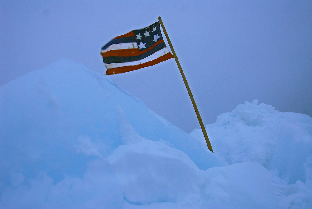 Alaska, Barrow. Captain Herbie Ahkivgak' crew flag on the ice. The flag is there because the crew just harvested a whale. Spring 2007