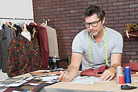 Mature male fashion designer working in design studio