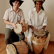 Alberto Lopez and Eduardo Martinez,  musicians and musical scholars both originally from Colombia, pose for a portrait while playing traditional Afro-Colombian instruments. The photo was taken in Los Angeles, California  on August 31, 2009. Photo by Jen Klewitz