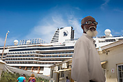 Jamaican tour guide awaits passengers from cruise ship, Ocho Rios.