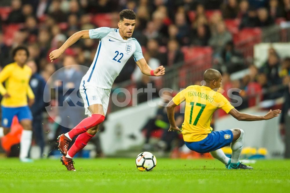 Dominic Solanke of England gets past Fernandinho of Brazil during the international friendly match between England and Brazil at Wembley Stadium, London, England on 14 November 2017. Photo by Darren Musgrove.