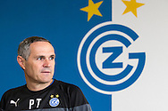 Head coach Pierluigi Tami poses for a photo in front of the club logo after a press conference of Super League (National League A) soccer team Grasshopper Club Zuerich (GCZ) held at the GC Campus in Niederhalsi, Switzerland, Friday, Feb. 6, 2015. (Photo by Patrick B. Kraemer / MAGICPBK)
