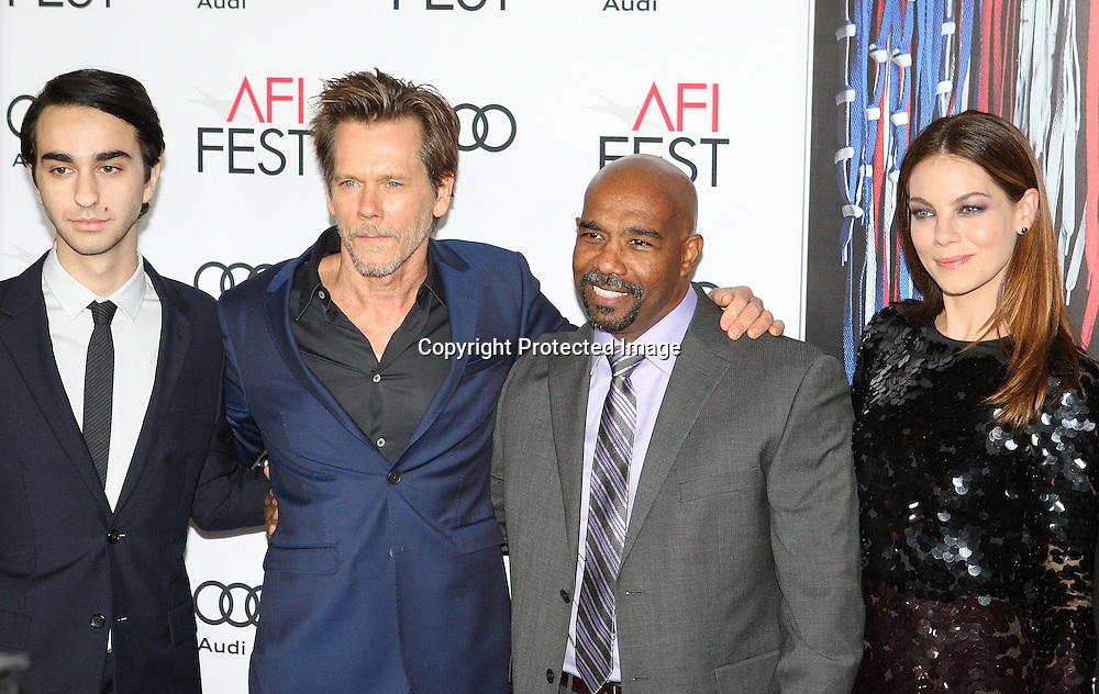 Actors Alex Wolf (L), Kevin Bacon, Michael Beach and Michelle Monaghan (R) attend the AFI 2016 Fest presented by AUDI closing night screening of Patriots Day at TCL Chinese Theatre, Hollywood, CA on November 17th